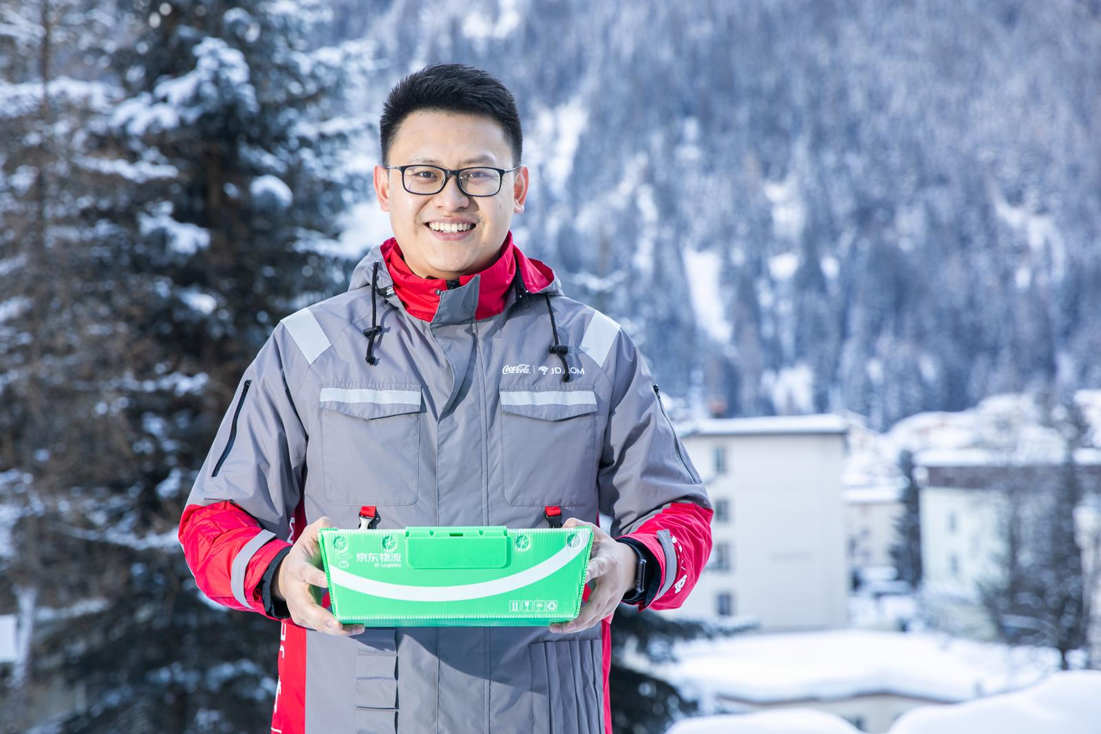 A JD.com staff wears a uniform made of recycled PET (rPET) materials co-created by Coca-Cola China and JD.com which demonstrates used PET bottles can be back to the value chain and be recycled into rPET products.